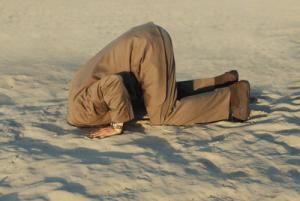 man-head-in-sand